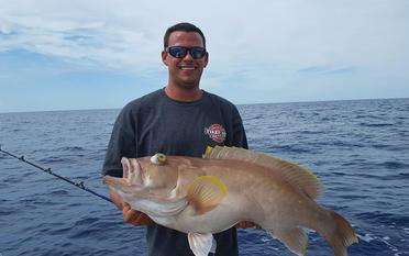 Captain Jimmy with a Yellowedge.   Deep Drop Fishing Charters